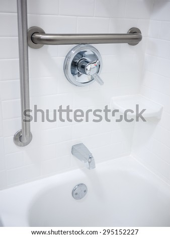 Handicapped disabled access bathroom shower bathtub with grab bars - stock photo
