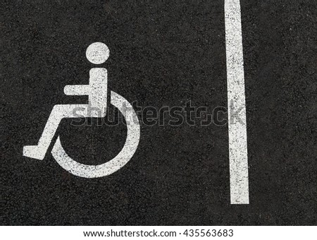 Handicapped disabled people parking lot sign for car wheel chair asphalt - stock photo