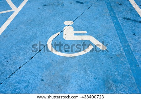 handicapped parking sign on the cement floor - stock photo