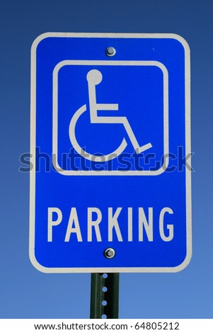 handicapped parking sign with blue sky background - stock photo