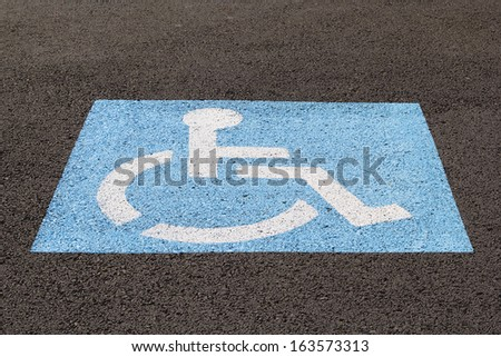 Handicapped Parking Space at Business Location Closeup - stock photo