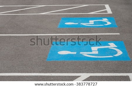 HANDICAPPED RESERVED PARKING SPACE - stock photo