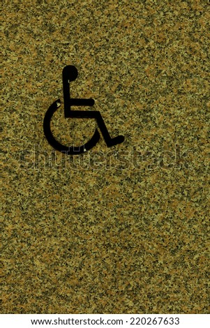 Handicapped sign on wall, detail of an information signal, disabled - stock photo