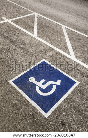 Handicapped Symbol Painted on a Parking Spot  - stock photo