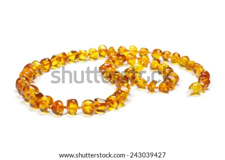Handicraft amber adornment isolated on te white background - stock photo