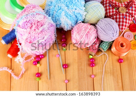 Handicraft supplies on wooden table close-up - stock photo