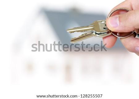 handing house keys - stock photo