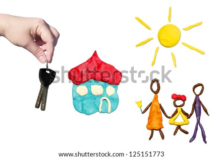 Handing over the key of new house to happy family (objects are executed from color plasticine) - stock photo