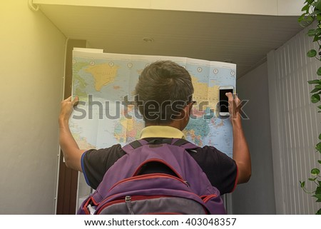 Handle phone and map - stock photo
