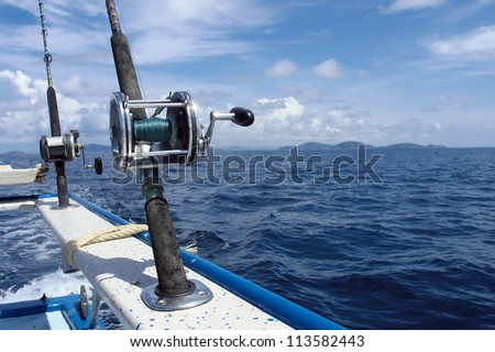 Handle rod and reel for saltwater fishing - stock photo