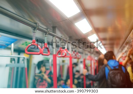 Handles for standing passenger in subway - stock photo