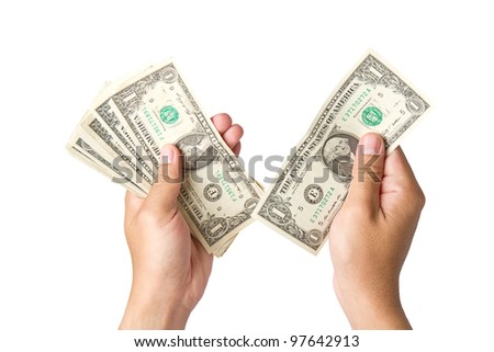 Handling us money, one  dollar bills on a white background - stock photo