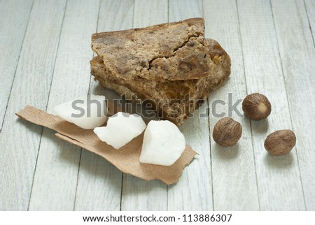handmade african black soap and ingredients, shea butter nuts and white shea butter - stock photo