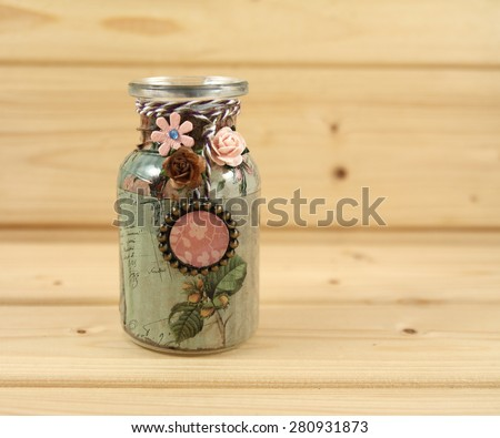 Handmade bottles decorated using different techniques of scrapbooking - stock photo