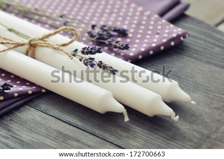 Handmade candles with dry lavender on wooden background, selective focus  - stock photo