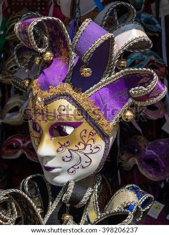 Handmade Carnival Venetian Mask in Gold, White and Purple - stock photo