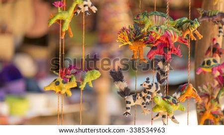 Handmade chameleons and lemur puppy toys - stock photo
