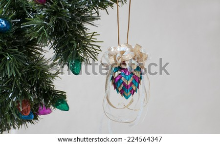 Handmade Christmas ornament made of ribbons - stock photo