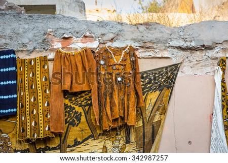 Handmade clothes in the alley of Marrakech Medina - stock photo