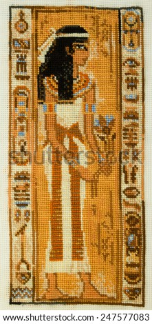 "Handmade cross-stitch ""Ancient Egyptian priestess"" my own work. - stock photo"