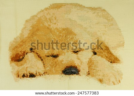"Handmade cross-stitch ""Cute puppy Labrador"" is my own work. - stock photo"