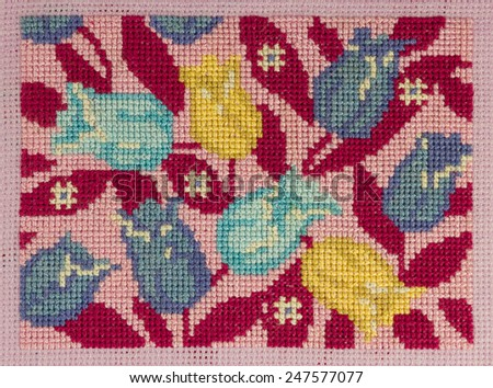 "Handmade cross-stitch ""Tulips on pink background"" is my own work. - stock photo"