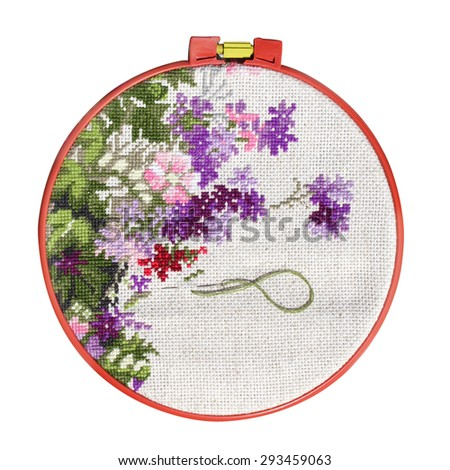 Handmade cross-stitch with floral pattern on canvas. Isolated on white background - stock photo