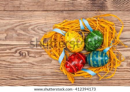 handmade easter eggs, nest in wooden background. Blank, greeting easter card  - stock photo