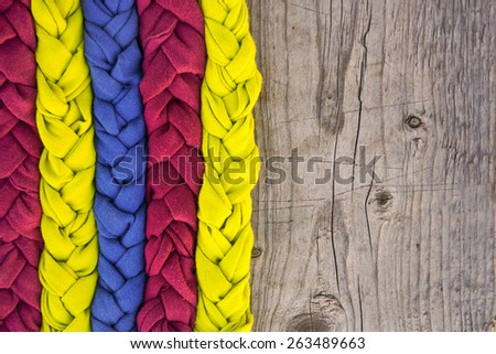Handmade fabric braids background. copy space - stock photo