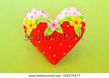 Handmade felt heart - symbol of Valentines Day, beautiful heart handmade  - stock photo