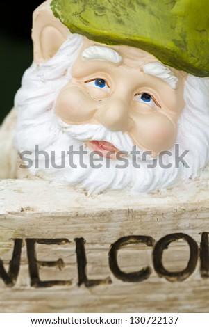 handmade garden gnomes on the display. - stock photo