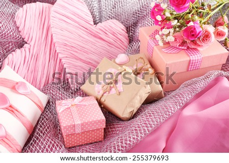 Handmade gifts on Valentine Day, on fabric background - stock photo