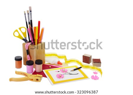 Handmade greeting card and selected craft materials and supplies. Pure white background, soft shadows. Copy space provided.  - stock photo