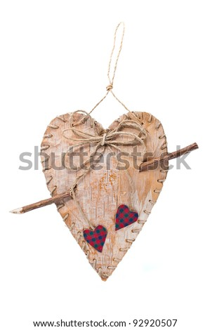 Handmade heart with a tree bark pierced wooden stick isolated on white background - stock photo