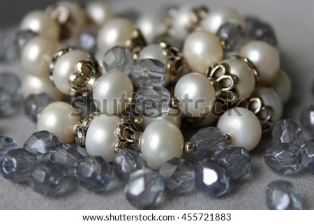 Handmade jewelry made of pearls and faceted beads. - stock photo