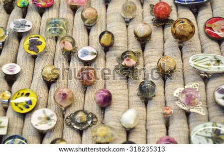 handmade jewelry, magical, beautiful earrings made of epoxy resin and plants and flowers  - stock photo