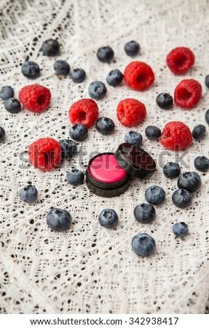 Handmade lip balm with raspberry flavor - stock photo