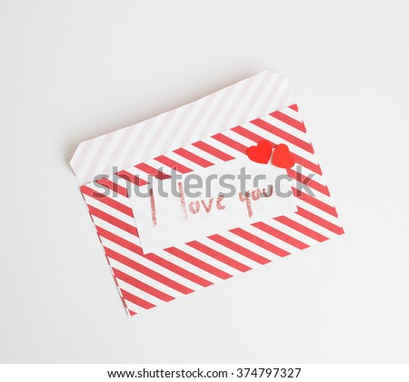 Handmade love letter  and little red hearts for valentine day on white background. - stock photo