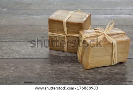Handmade organic olive-laurel soap on wooden background - stock photo