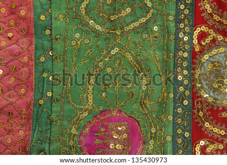 Handmade patchwork quilt from India as background - stock photo