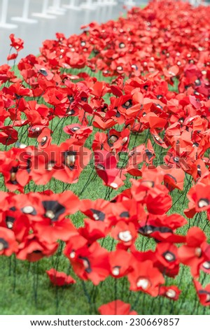 Handmade Poppies at the Imperial War museum, as a tribute to the dead in the great war. - stock photo