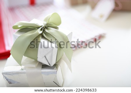 Handmade present boxes with light green ribbon - stock photo
