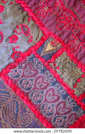 handmade quilt as background - stock photo