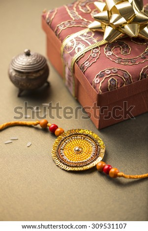 Handmade Raakhi and a gift for the sister given by brother on the occasion of Raksha Bandhan. - stock photo