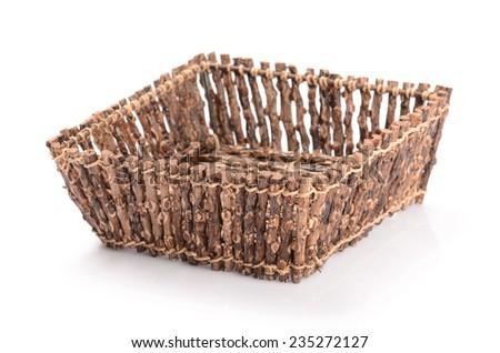 handmade rattan basket isolated on white - stock photo