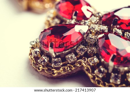 Handmade red earrings with jewels. Vintage style - stock photo