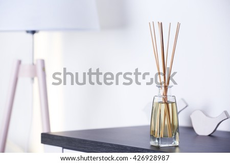 Handmade reed freshener on commode in living room, close up - stock photo