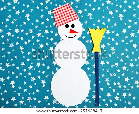 Handmade snowman on bright background - stock photo
