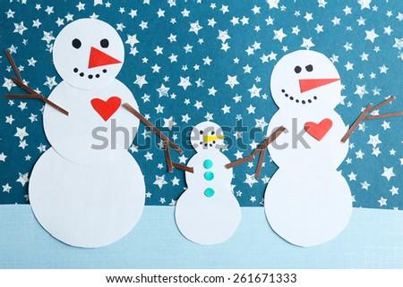 Handmade snowmen on bright background - stock photo