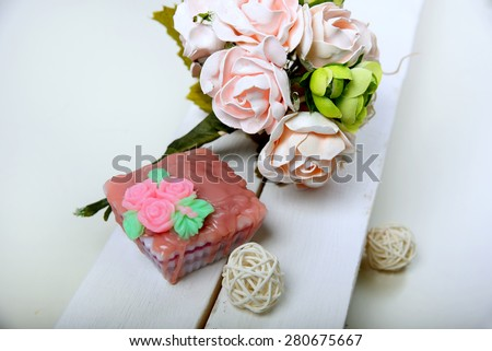 Handmade soap. Shaped Cake. Bouquet of pink flowers - stock photo